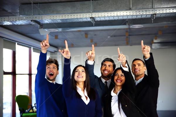 Gruppo uomini d'affari punta up ufficio Foto d'archivio © deandrobot