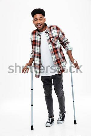 Full length portrait of dissatisfied man over white background Stock photo © deandrobot