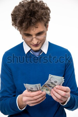 Handsome business man in glasses counting money Stock photo © deandrobot