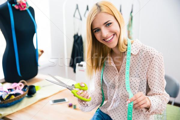 Feminino alfaiate em pé oficina feliz moda Foto stock © deandrobot