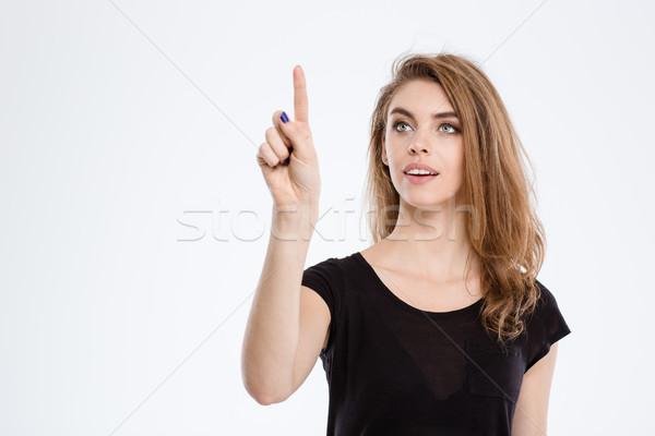 счастливым женщину прикасаться невидимый экране портрет Сток-фото © deandrobot