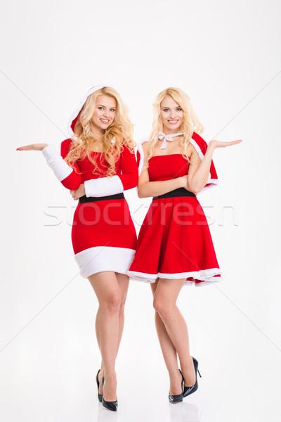 Nővérek ikrek mikulás jelmezek tart copy space Stock fotó © deandrobot