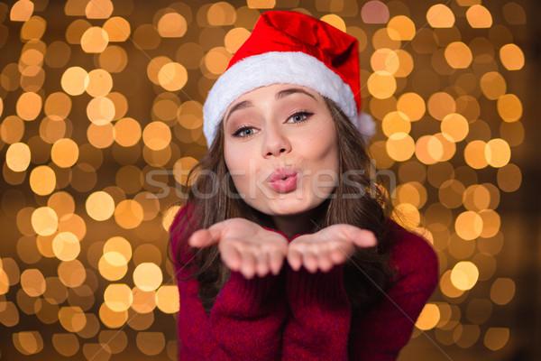 Csinos aranyos fürtös lány mikulás kalap Stock fotó © deandrobot