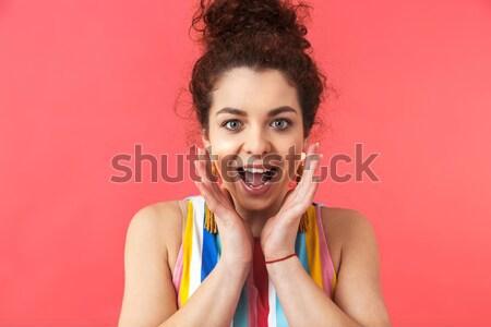 Izgatott boldog fiatal nő tart szeletek narancs Stock fotó © deandrobot
