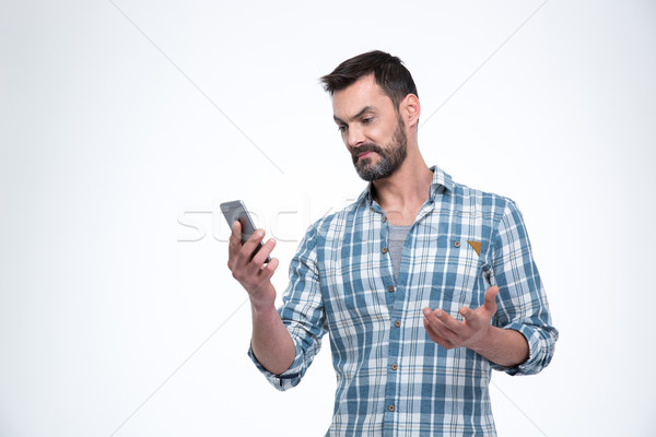 Man holding smartphone Stock photo © deandrobot