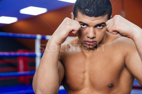 Handsome male boxer Stock photo © deandrobot