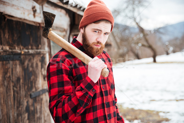Handsome bearded man with axe in village Stock photo © deandrobot