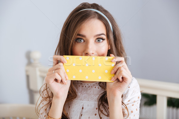 Beautiful young woman covered her face with napkin in cafe  Stock photo © deandrobot