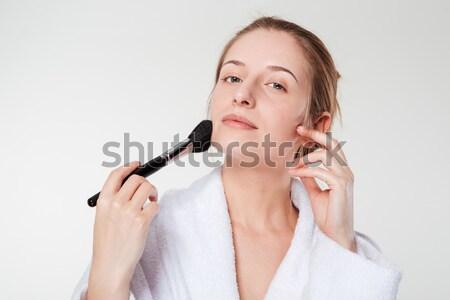 Woman applying blusher Stock photo © deandrobot