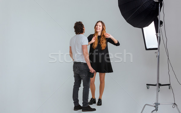 Male photographer speaking with female model Stock photo © deandrobot