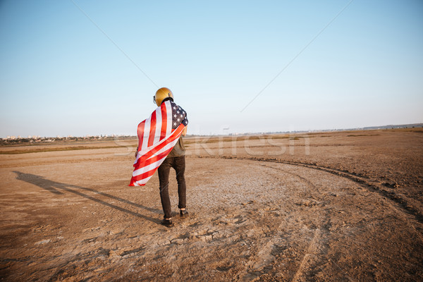 Man wearing american flag cape and golden helmet walking away Stock photo © deandrobot