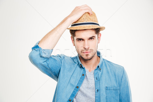 Attractive bristled young man in blue shirt and hat Stock photo © deandrobot