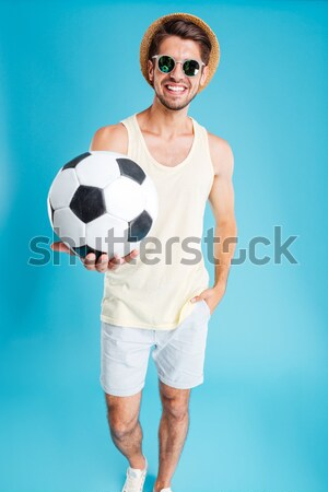 Young happy couple in swimsuits holding balls Stock photo © deandrobot