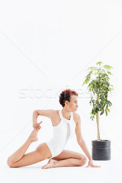 Vonzó afroamerikai nő nyújtás gyakorol jóga Stock fotó © deandrobot