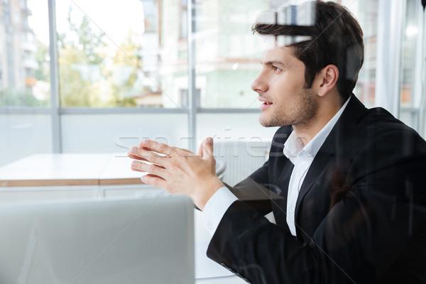 Işadamı siyah takım elbise oturma ofis yakışıklı genç Stok fotoğraf © deandrobot