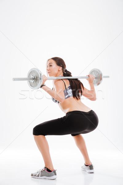 Obraz fitness dziewczyna sztanga widok z tyłu Zdjęcia stock © deandrobot
