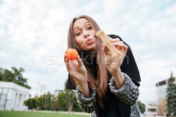 Sevimli kadın oynama küçük top kemik Stok fotoğraf © deandrobot