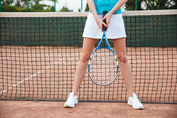 Portrait of female legs with tennis racket Stock photo © deandrobot