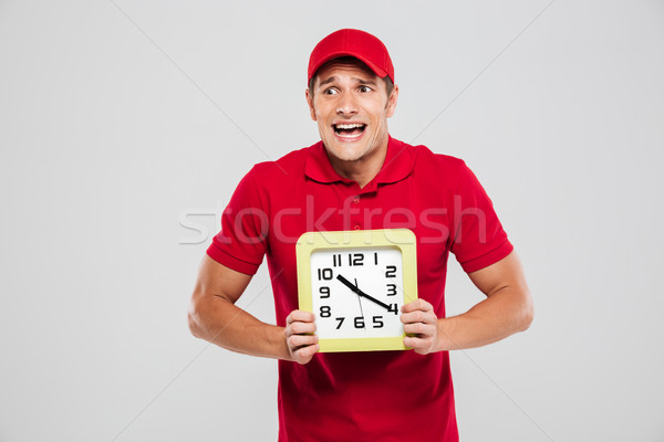 Funny delivery man with clock Stock photo © deandrobot