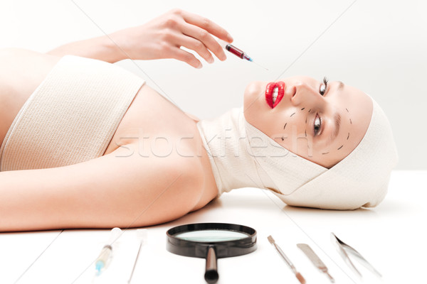 Model in bandages lying Stock photo © deandrobot