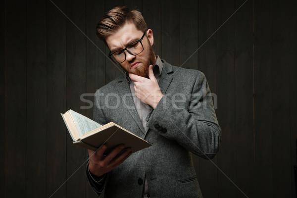 Portre dalgın sakallı adam gözlük okuma Stok fotoğraf © deandrobot
