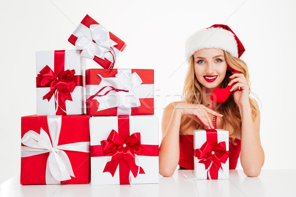 Woman in santa claus costume talking on telephone Stock photo © deandrobot
