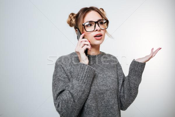 очки Постоянный говорить сотового телефона привлекательный Сток-фото © deandrobot