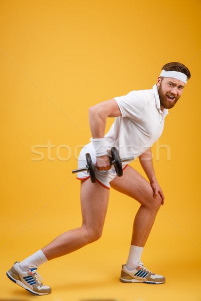 Vista lateral barbado ejercicio mirando Foto stock © deandrobot
