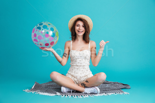 Portrait of a happy cheerful summer girl in straw hat Stock photo © deandrobot