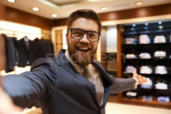 Happy businessman showing wardrobe Stock photo © deandrobot