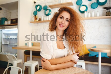 Stock photo: Amazing beautiful redhead young lady standing in cafe