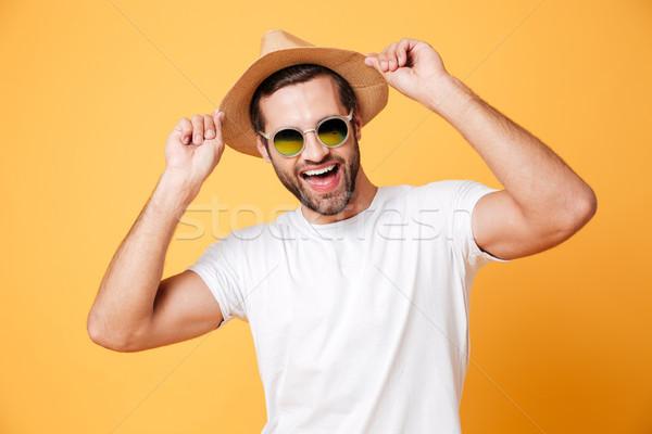 Mutlu genç ayakta yalıtılmış sarı resim Stok fotoğraf © deandrobot