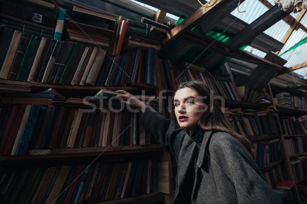 портрет модный женщину пальто книга Сток-фото © deandrobot