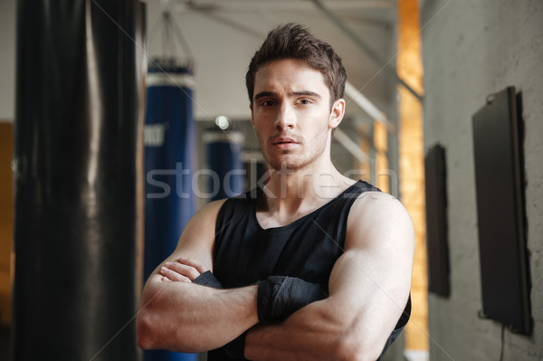 Serious boxer standing with crossed arms Stock photo © deandrobot