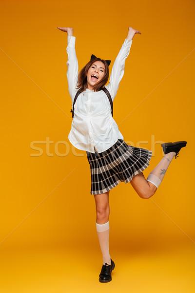 Full length portrait of a cheerful teenage schoolgirl Stock photo © deandrobot