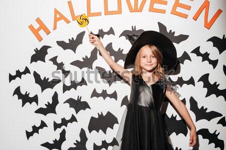 érzelmes fiatal nő boszorkány halloween jelmez fotó Stock fotó © deandrobot