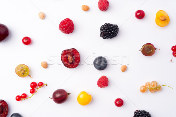 Mix of berries isolated over white background table. Stock photo © deandrobot