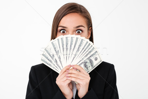 Shocked business woman covering face holding money Stock photo © deandrobot