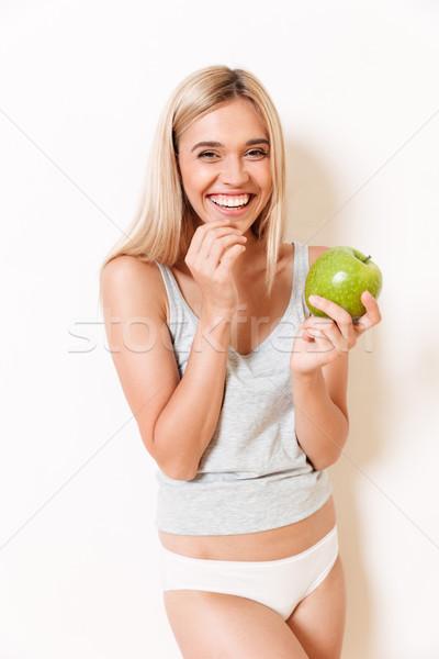Portré mosolyog aranyos lány alsónemű tart Stock fotó © deandrobot