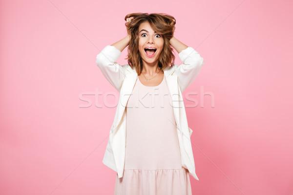 Portré izgatott boldog lány tart karok haj Stock fotó © deandrobot