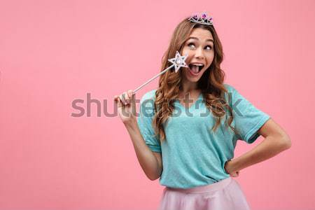 Close-up photo of happy brunette girl dressed like princess hold Stock photo © deandrobot