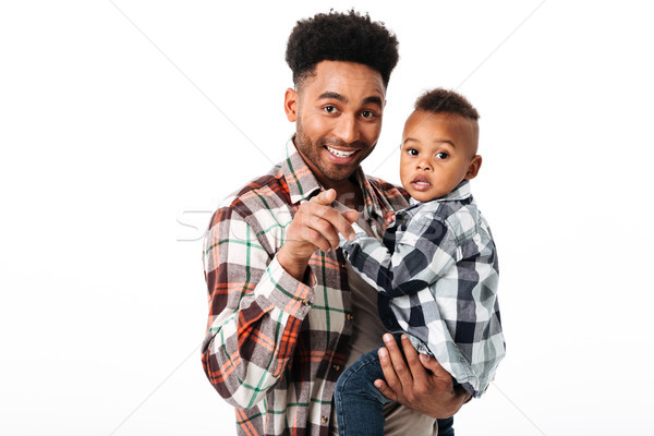 Portrait of a smiling african man holding his little son Stock photo © deandrobot