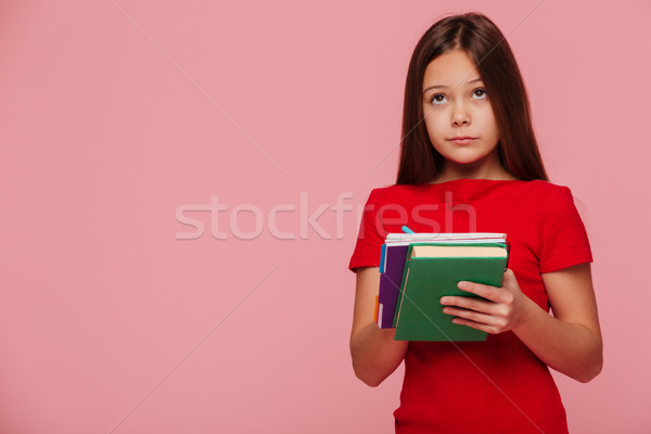 Pensive Girl Pupil Looking At Copy Space And Holding Books Stock Photo C Dean Drobot Deandrobot 8817218 Stockfresh
