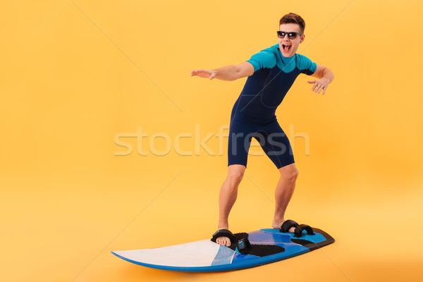 счастливым Surfer Солнцезащитные очки доска для серфинга подобно волна Сток-фото © deandrobot