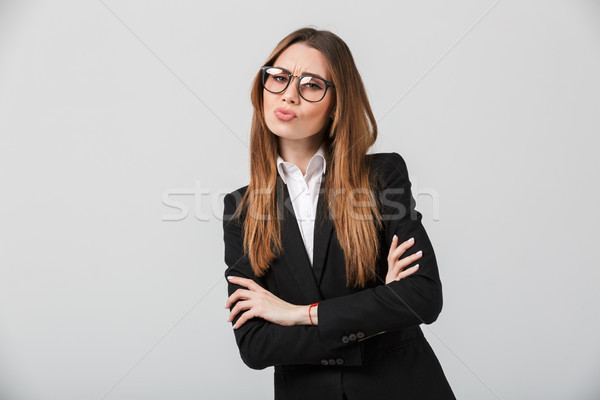 Portrait of a disappointed businesswoman Stock photo © deandrobot