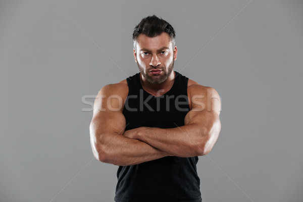 Portrait of a confident strong male bodybuilder Stock photo © deandrobot
