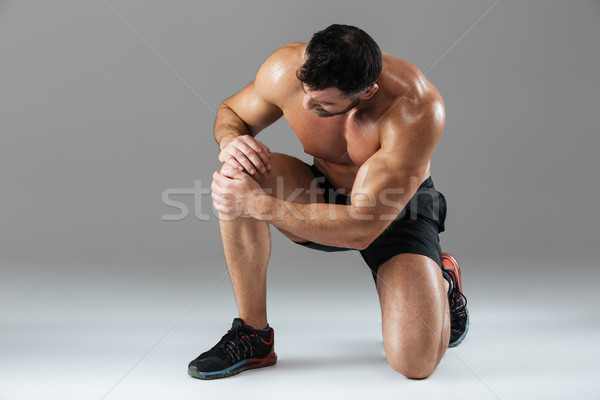 Portrait of a strong muscular male bodybuilder Stock photo © deandrobot