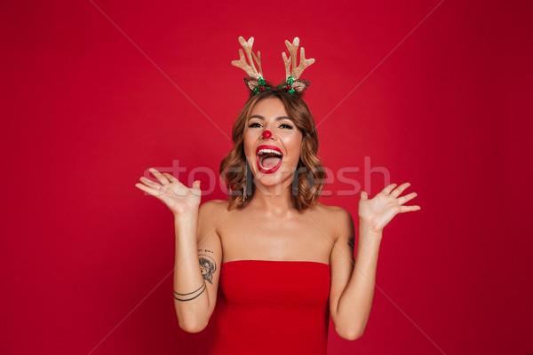 Portrait of a joyful amused girl wearing christmas deer costume Stock photo © deandrobot