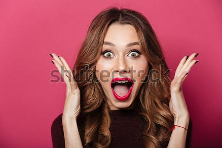 Shocked beautiful lady with make up looking camera Stock photo © deandrobot