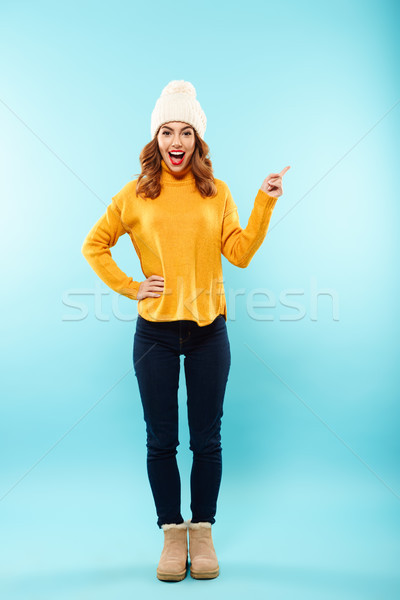 Full length portrait of an excited young girl Stock photo © deandrobot